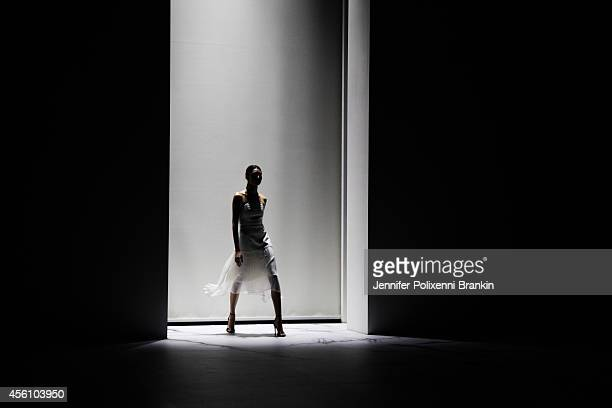 A model walks the runway at the MB Presents Australian Style show during MercedesBenz Fashion Festival Sydney at Sydney Town Hall on September 24...