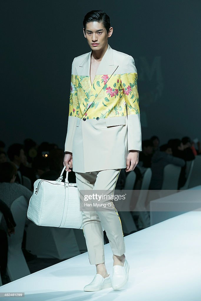A model walks the runway at the MCM S/S 2014 Seoul Fashion Show at Lotte Hotel on November 26, 2013 in Seoul, South Korea.