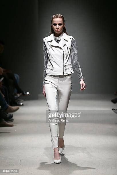 A model walks the runway at the Meltem Ozbek show during Mercedes Benz Fashion Week Istanbul FW15 on March 16 2015 in Istanbul Turkey