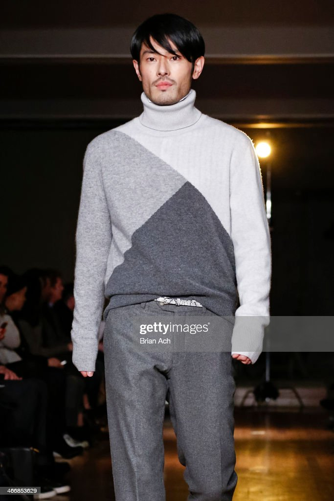 A model walks the runway at the Michael Bastian fall 2014 fashion show at Rubin Museum of Art on February 4, 2014 in New York City.