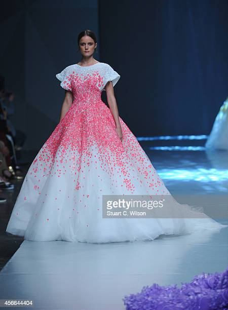 A model walks the runway at the Michael Cinco show during Fashion Forward at Madinat Jumeirah on October 4 2014 in Dubai United Arab Emirates