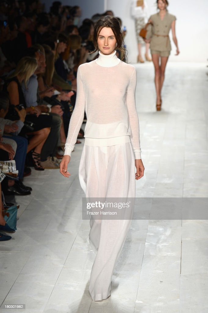 A model walks the runway at the Michael Kors fashion show during Mercedes-Benz Fashion Week Spring 2014 at The Theatre at Lincoln Center on September 11, 2013 in New York City.