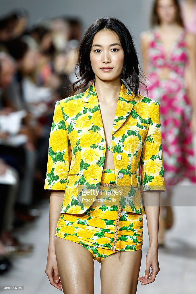 A model walks the runway at the Michael Kors fashion show during MercedesBenz Fashion Week Spring 2015 at Spring Studios on September 10 2014 in New...