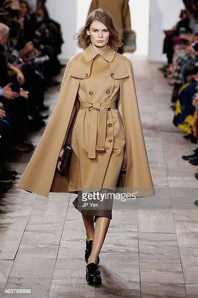 A model walks the runway at the Michael Kors fashion show during MercedesBenz Fashion Week Fall at Spring Studios on February 18 2015 in New York City