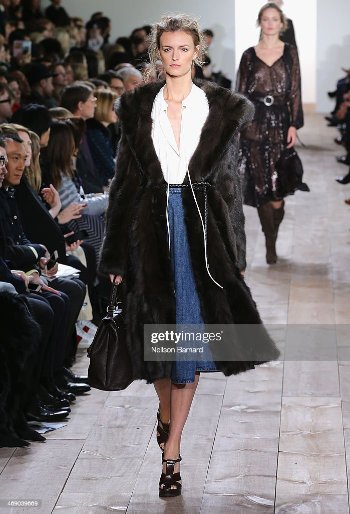 A model walks the runway at the Michael Kors fashion show during Mercedes-Benz Fashion Week Fall 2014 on February 12, 2014 in New York City.