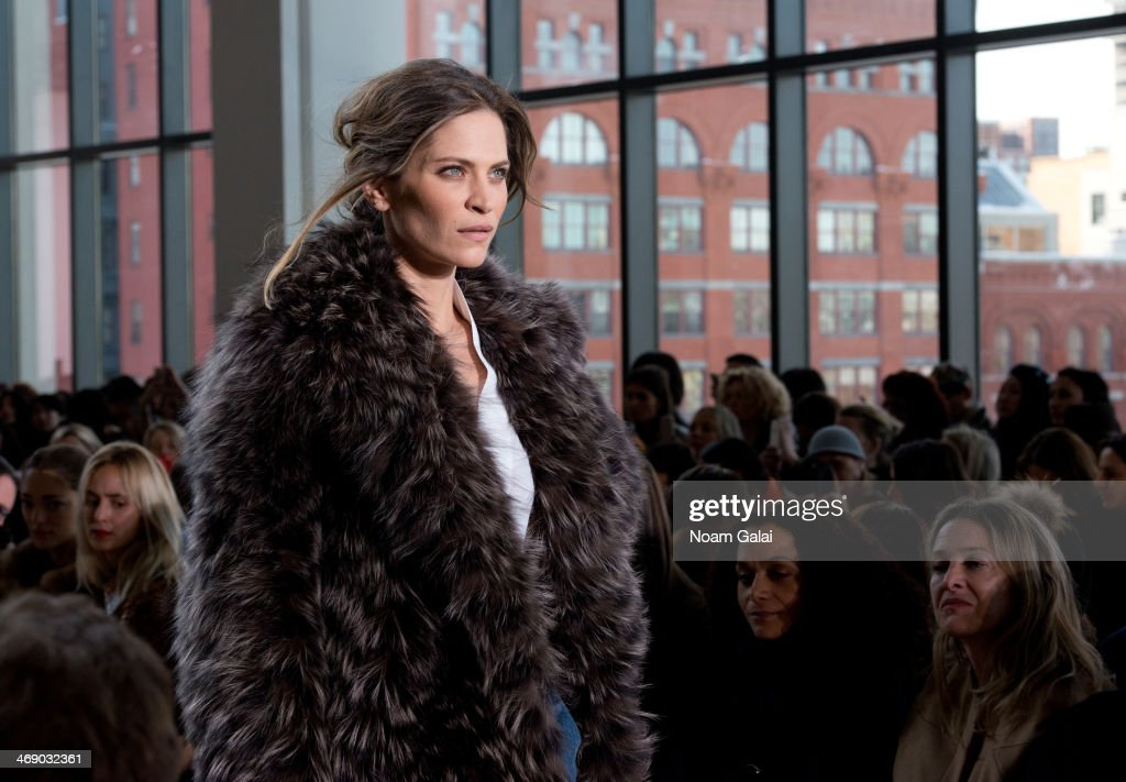 A model walks the runway at the Michael Kors Show during Mercedes-Benz Fashion Week Fall 2014 at Spring Studios on February 12, 2014 in New York City.