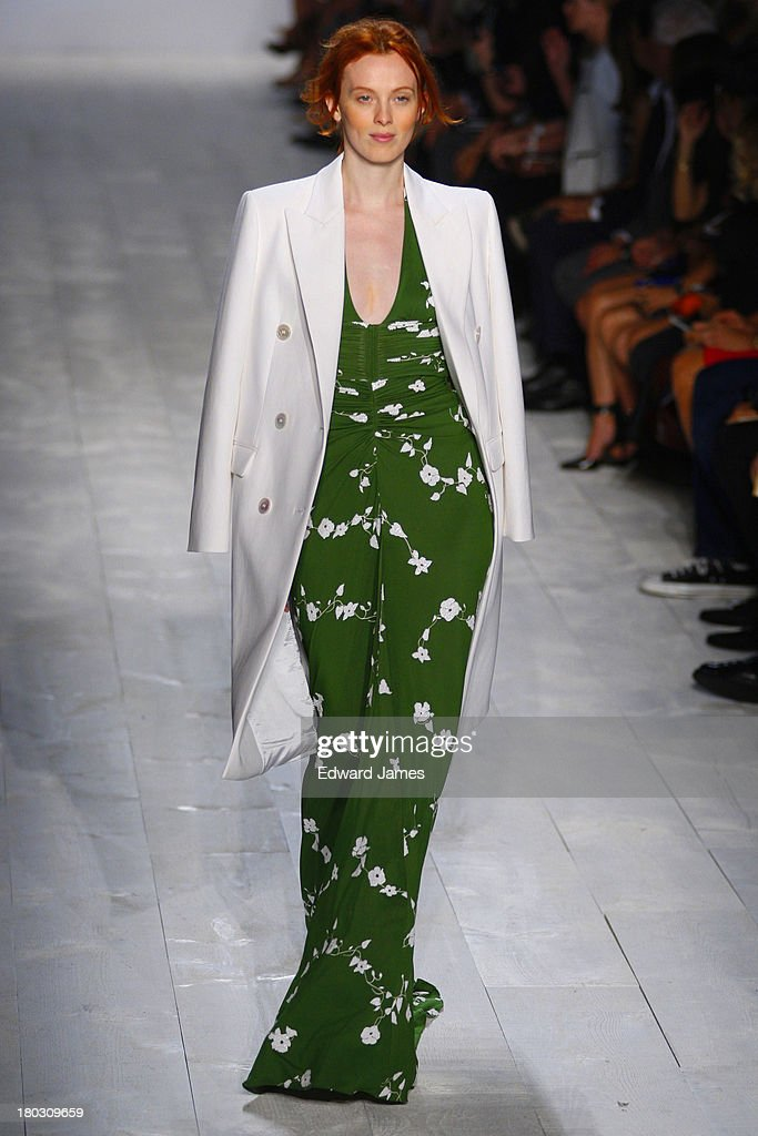 A model walks the runway at the Michael Kors show during Spring 2014 Mercedes-Benz Fashion Week at The Theatre at Lincoln Center on September 11, 2013 in New York City.