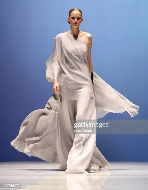 A model walks the runway at the Michalsky Show at the Michalsky Style Nite at Tempodrom during the Mercedes Benz Fashion Week Spring/Summer 2011 on...