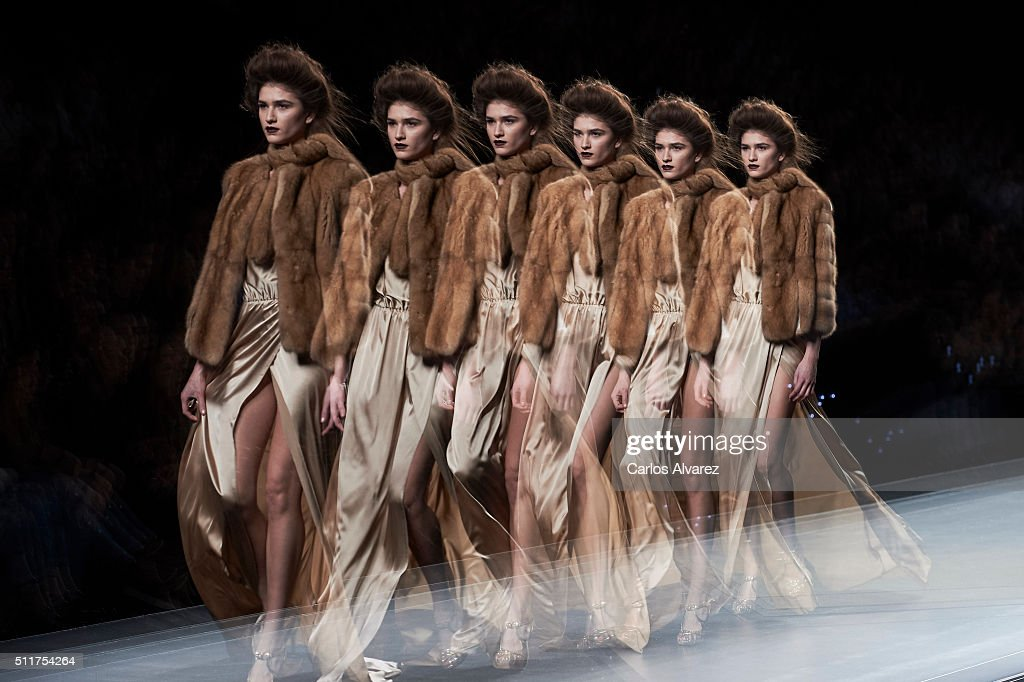 A model walks the runway at the Miguel Merinero show during the MercedesBenz Madrid Fashion Week Autumn/Winter 2016/2017 at Ifema on February 22 2016...