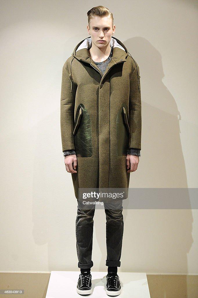 A model walks the runway at the Miharayasuhiro Autumn Winter 2014 fashion show during Paris Menswear Fashion Week on January 18, 2014 in Paris, France.