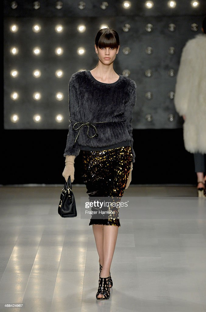 A model walks the runway at the Milly By Michelle Smith fashion show during Mercedes-Benz Fashion Week Fall 2014 at Lincoln Center on February 10, 2014 in New York City.