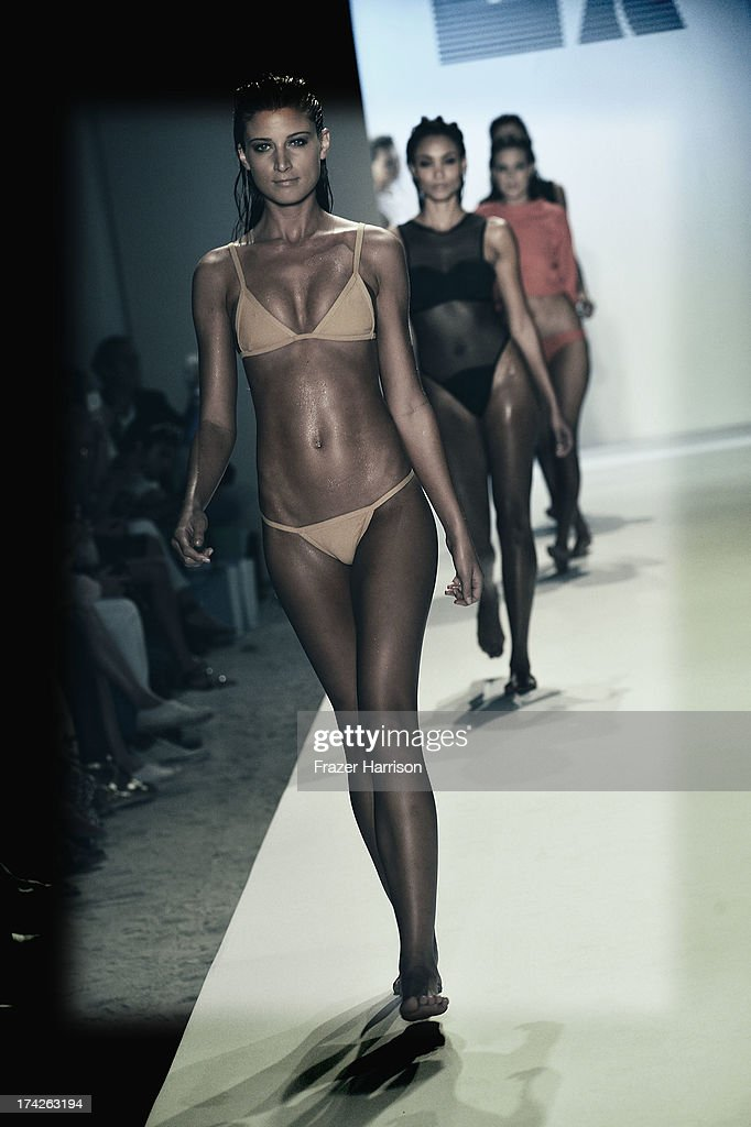 A model walks the runway at the Minimale Animale show during Mercedes-Benz Fashion Week Swim 2014 at the Raleigh on July 22, 2013 in Miami Beach, Florida.