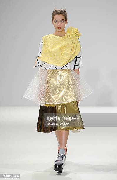 A model walks the runway at the Minnan Hui show during London Fashion Week Fall/Winter 2015/16 at Fashion Scout Venue on February 20 2015 in London...