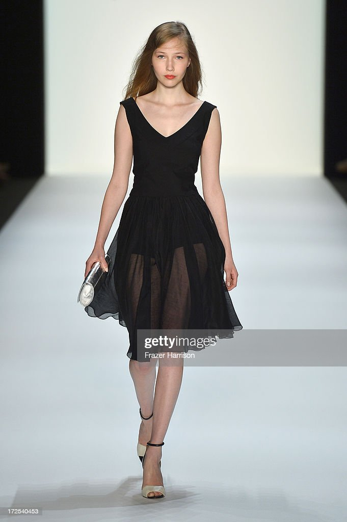 A model walks the runway at the Minx By Eva Lutz show during Mercedes-Benz Fashion Week Spring/Summer 2014 at Brandenburg Gate on July 3, 2013 in Berlin, Germany.