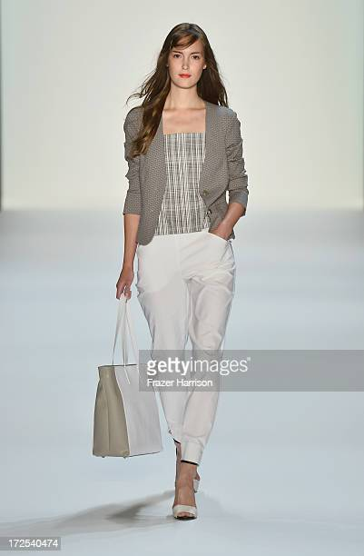 A model walks the runway at the Minx By Eva Lutz show during MercedesBenz Fashion Week Spring/Summer 2014 at Brandenburg Gate on July 3 2013 in...