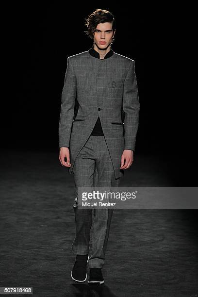 A model walks the runway at the Miquel Suay show during the Barcelona 080 Fashion Week Autumn/Winter 2016/2017 at Casa Llotja de Mar on February 1...