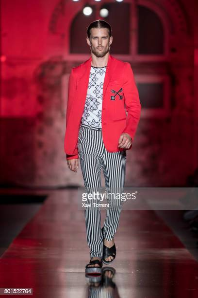 A model walks the runway at the Miquel Suay show during the Barcelona 080 Fashion Week on June 26 2017 in Barcelona Spain