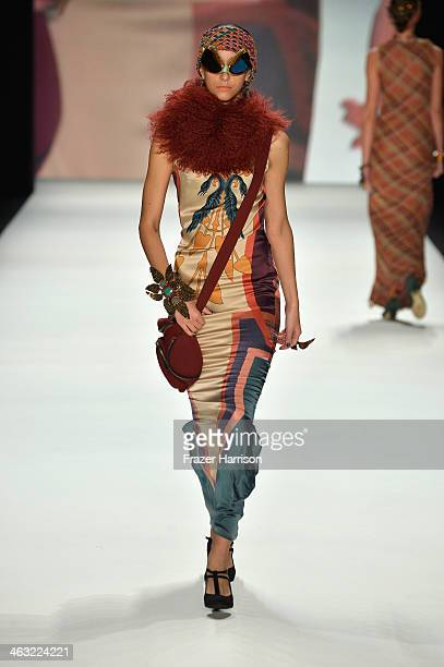 A model walks the runway at the Miranda Konstantinidou show during MercedesBenz Fashion Week Autumn/Winter 2014/15 at Brandenburg Gate on January 17...