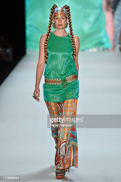 A model walks the runway at the Miranda Konstantinidou Show during the MercedesBenz Fashion Week Spring/Summer 2014 at Brandenburg Gate on July 5...