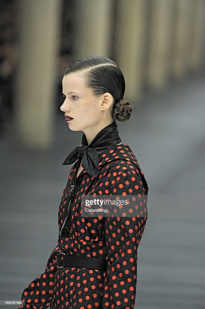 A model walks the runway at the Miu Miu Autumn Winter 2013 fashion show during Paris Fashion Week on March 6 2013 in Paris France