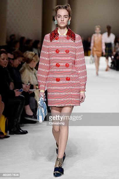 A model walks the runway at the Miu Miu Autumn Winter 2015 fashion show during Paris Fashion Week on March 11 2015 in Paris France