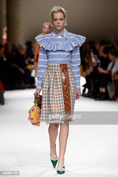 A model walks the runway at the Miu Miu Autumn Winter 2015 fashion show during Paris Fashion Week on March 11 2015 in Paris France