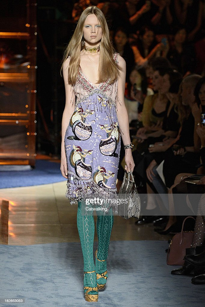 A model walks the runway at the Miu Miu Spring Summer 2014 fashion show during Paris Fashion Week on October 2, 2013 in Paris, France.