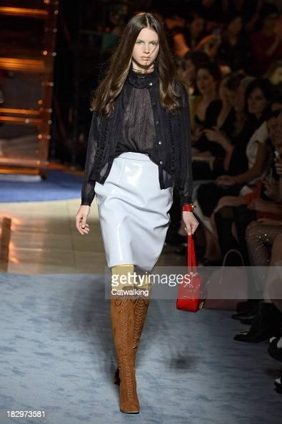 A model walks the runway at the Miu Miu Spring Summer 2014 fashion show during Paris Fashion Week on October 2 2013 in Paris France
