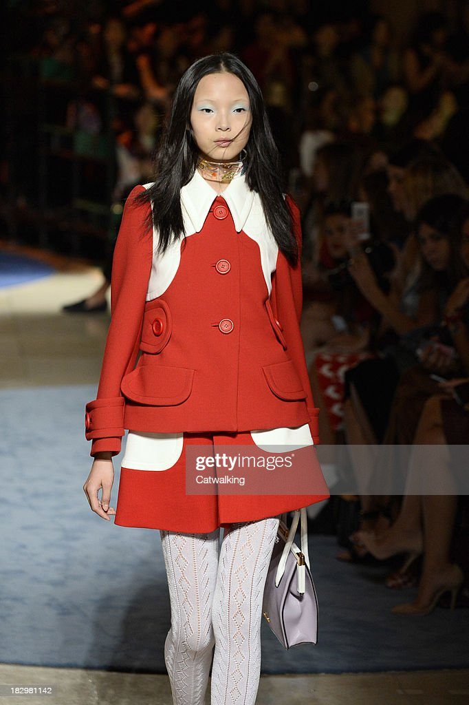 A model walks the runway at the Miu Miu Spring Summer 2014 fashion show during Paris Fashion Week on October 2, 2013 in Paris, France.