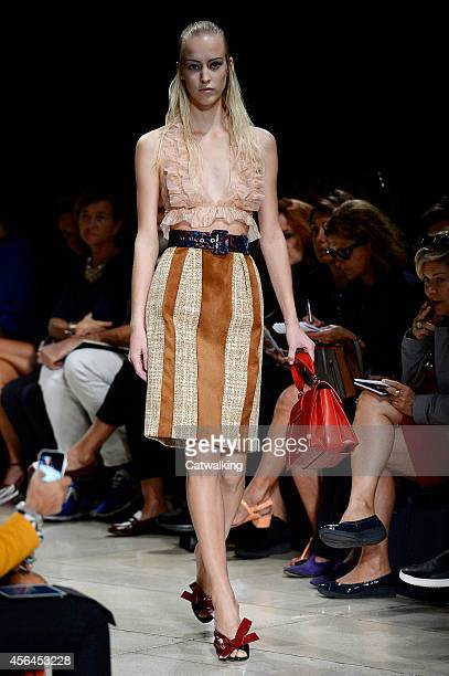 A model walks the runway at the Miu Miu Spring Summer 2015 fashion show during Paris Fashion Week on October 1 2014 in Paris France
