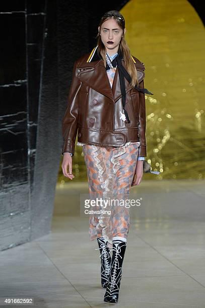 A model walks the runway at the Miu Miu Spring Summer 2016 fashion show during Paris Fashion Week on October 7 2015 in Paris France