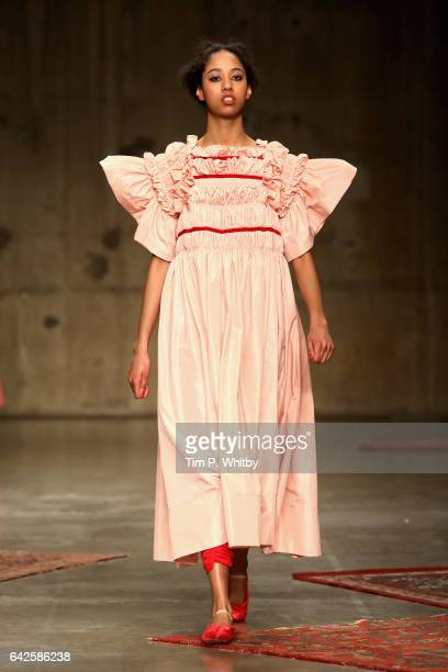 A model walks the runway at the Molly Goddard show during the London Fashion Week February 2017 collections on February 18 2017 in London England