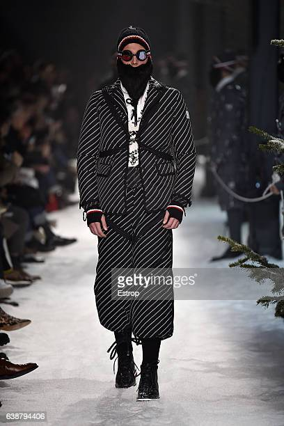 A model walks the runway at the Moncler Gamme Bleu designed by Thom Browne show during Milan Men's Fashion Week Fall/Winter 2017/18 on January 15...