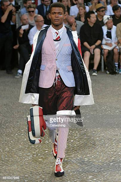 A model walks the runway at the Moncler Gamme Bleu Spring Summer 2015 fashion show during Milan Menswear Fashion Week on June 22 2014 in Milan Italy