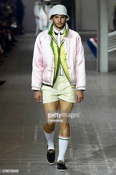 A model walks the runway at the Moncler Gamme Bleu Spring Summer 2016 fashion show during Milan Menswear Fashion Week on June 21 2015 in Milan Italy