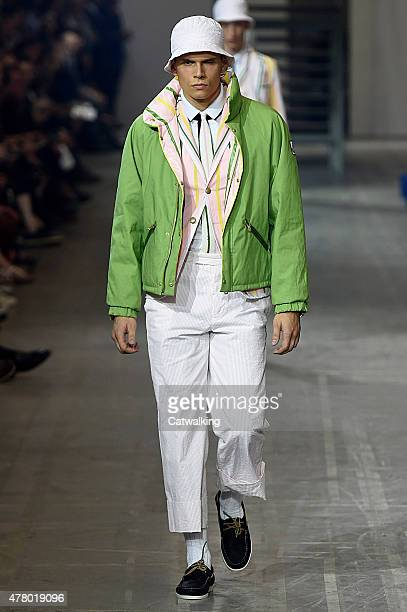 A model walks the runway at the Moncler Gamme Bleu Spring Summer 2016 fashion show during Milan Menswear Fashion Week on June 21 2015 in Milan Italy