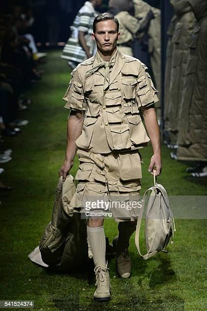 A model walks the runway at the Moncler Gamme Bleu Spring Summer 2017 fashion show during Milan Menswear Fashion Week on June 19 2016 in Milan Italy