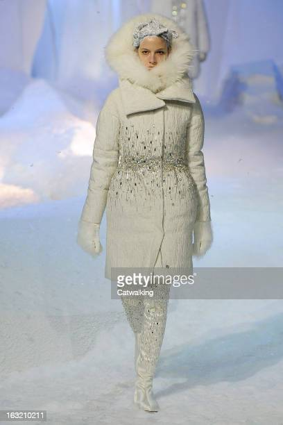 A model walks the runway at the Moncler Gamme Rouge Autumn Winter 2013 fashion show during Paris Fashion Week on March 6 2013 in Paris France