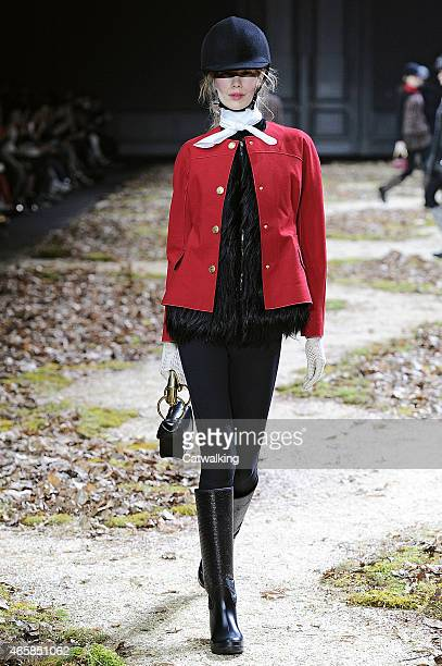 A model walks the runway at the Moncler Gamme Rouge Autumn Winter 2015 fashion show during Paris Fashion Week on March 11 2015 in Paris France