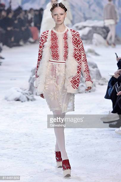 A model walks the runway at the Moncler Gamme Rouge Autumn Winter 2016 fashion show during Paris Fashion Week on March 9 2016 in Paris France