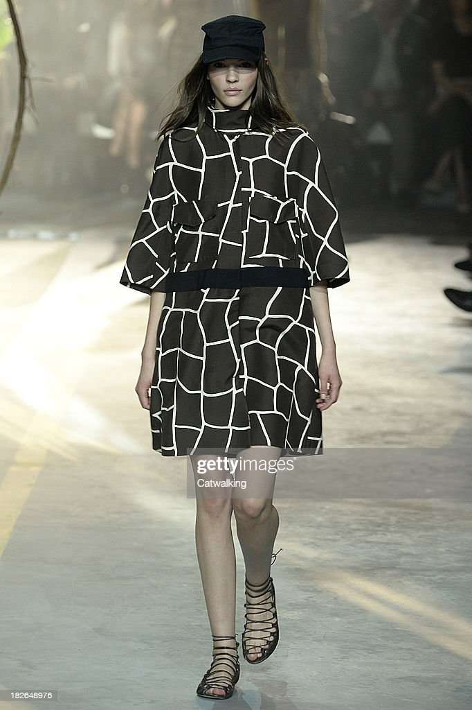 A model walks the runway at the Moncler Gamme Rouge Spring Summer 2014 fashion show during Paris Fashion Week on October 2, 2013 in Paris, France.