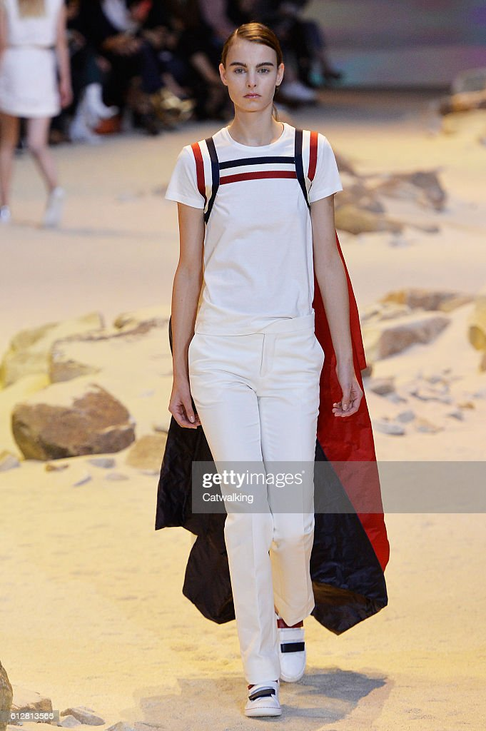 model-walks-the-runway-at-the-moncler-gamme-rouge-spring-summer-2017-picture-id612813566