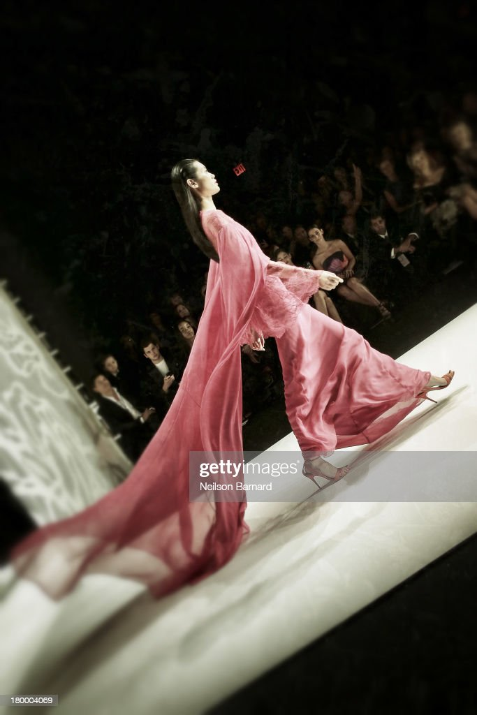 A model walks the runway at the Monique Lhuillier Fashion show during Mercedes-Benz Fashion Week Spring 2014 on September 7, 2013 in New York City.