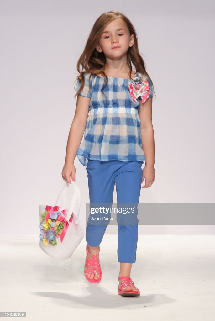 A model walks the runway at the Monnalisa show during Petite Parade NY Kids Fashion Week In Collaboration With VOGUEbambini - Day 2 at Industria Superstudio on October 21, 2012 in New York City.