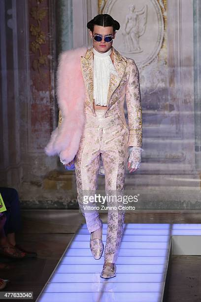 A model walks the runway at the Moschino Men's Fashion Show Spring/Summer 2016 during the 88 Pitti Uomo on June 18 2015 in Florence Italy