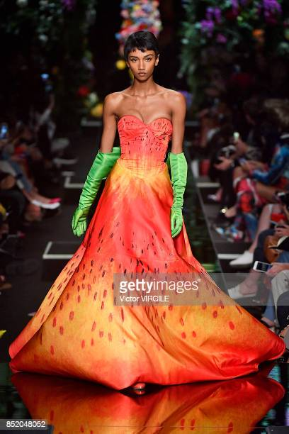 A model walks the runway at the Moschino Ready to Wear Spring/Summer 2018 fashion show during Milan Fashion Week Spring/Summer 2018 on September 21...