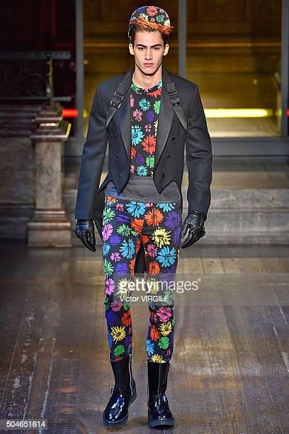 A model walks the runway at the Moschino show during The London Collections Men AW16 on January 10 2016 in London England