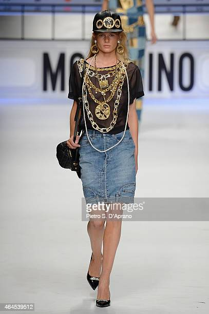 A model walks the runway at the Moschino show during the Milan Fashion Week Autumn/Winter 2015 on February 26 2015 in Milan Italy