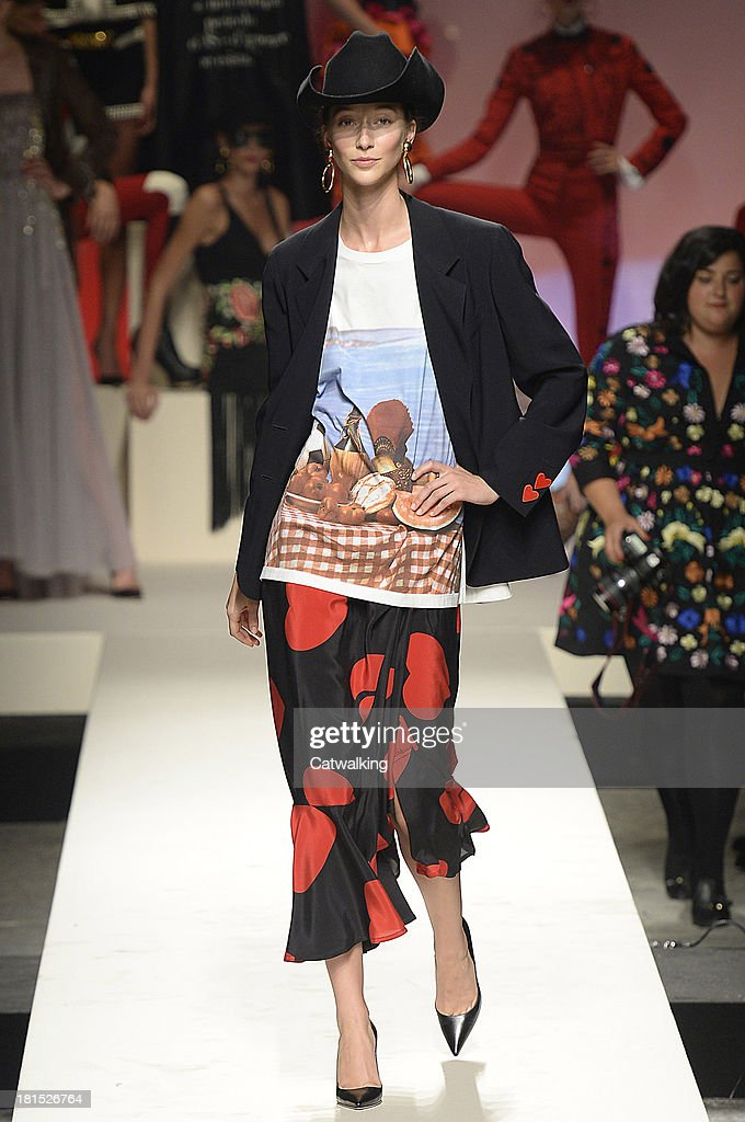A model walks the runway at the Moschino Spring Spring Summer 2014 fashion show during Milan Fashion Week on September 21, 2013 in Milan, Italy.