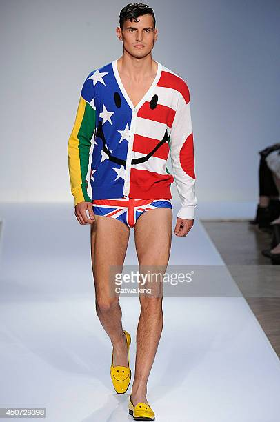A model walks the runway at the Moschino Spring Summer 2015 fashion show during London Menswear Fashion Week on June 16 2014 in London United Kingdom